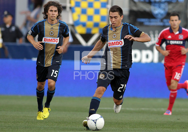 CHESTER, PA - AUGUST 12, 2012:  Twins Michael Farfan (21) and Gabriel Farfan (15) of the Philadelphia Union on the attack against the Chicago Fire during an MLS match at PPL Park, in Chester, PA on August 12. Fire won 3-1.