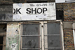 Derelict shop with Merry Xmas message, East End, London, England