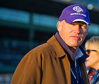 Trainer John Gosden watches his horses exercise for the Breeders' Cup at Santa Anita Park in Arcadia, California on October 30, 2013.