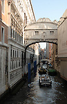 Transporting goods by boat passing under the famous bridge of sighs, Venice, Italy.