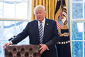 U.S. President Donald J. Trump prepares to sign three executive actions shortly after Attorney General Jeff Sessions was sworn-in by Vice President Mike Pence in the Oval Office of the White House in Washington, DC, USA, 09 February 2017. On 08 February, after a contentious battle on party lines, the Senate voted to confirm Sessions as attorney general.<br /> Credit: Jim LoScalzo / Pool via CNP