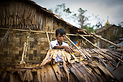 An young boy is seen working towards on reconstruction process themselves in their houses that were destroyed by cyclone Nargis in Thanlyin area, 70 kms east of the capital Yangon. With no help from anywhere, the villagers have taken it to themselves are are seen reconstructing their village slowly.