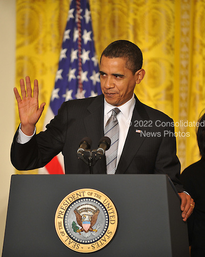 "Washington, D.C. - March 2, 2009 -- United States President Barack Obama waves to reporters after naming Governor Kathleen Sebelius (Democrat of Kansas) as Secretary of the Department of Health and Human Services (HHS) in the East Room of the White House in Washington, DC on Monday, March 2, 2009.  The President also announced the release of $155 million authorized by the American Recovery and Reinvestment Act (ARRA) that will support 126 new health centers.  In a release, the White House stated ""These health centers will help people in need - many with no health insurance - obtain access to comprehensive primary and preventive health care services."".Credit: Ron Sachs / Pool via CNP"
