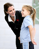 31 October 2017 - Princess Kate, Duchess of Cambridgetalks with a girl as she takes part in a Tennis for Kids session during a visit at the Lawn Tennis Association (LTA) at the National Tennis Centre in southwest London. Duchess of Cambridge visited the LTA, the national governing body of tennis, where she was briefed on the organisations latest activities and objectives, and had the opportunity to watch a number of tennis demonstrations at the National Tennis Centre's on-court facilities. Photo Credit: ALPR/AdMedia