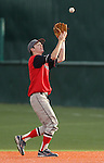 Coronado Cougars' Tyler Brown catches a fly ball against the Reno Huskies' Kellen Richards in the NIAA 4A baseball championship tournament in Reno, Nev. on Thursday, May 16, 2012. Reno won 6-5..Photo by Cathleen Allison