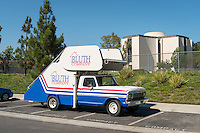 "The iconic stair car from the television series, ""Arrested Development"" sits on the campus of Occidental College, with Herrick Chapel behind, on Aug. 8, 2012, Los Angeles, Calif. The production used the campus for filming. (Photo by Marc Campos, Occidental College Photographer)"
