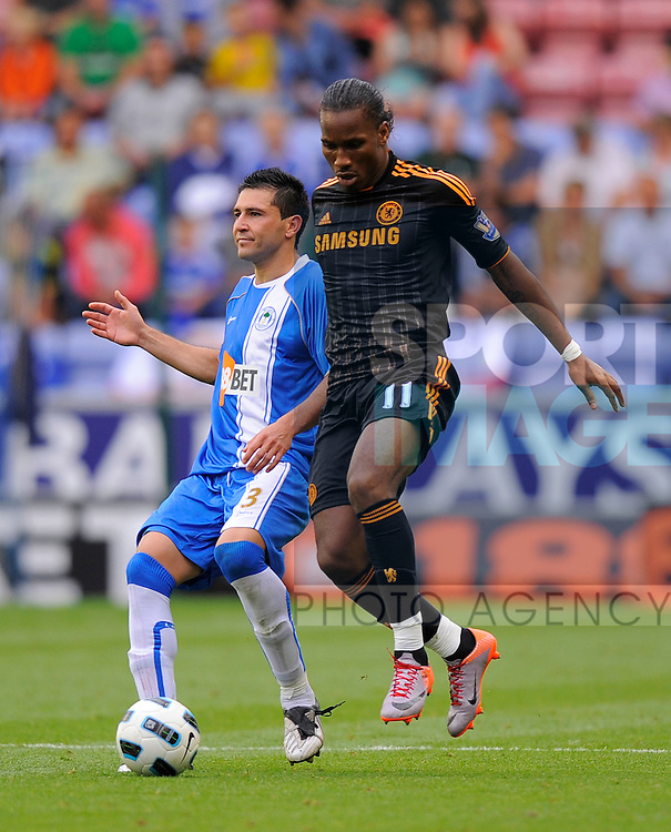 Antolin Alcaraz of Wigan Athletic and Didier Drogba of Chelsea