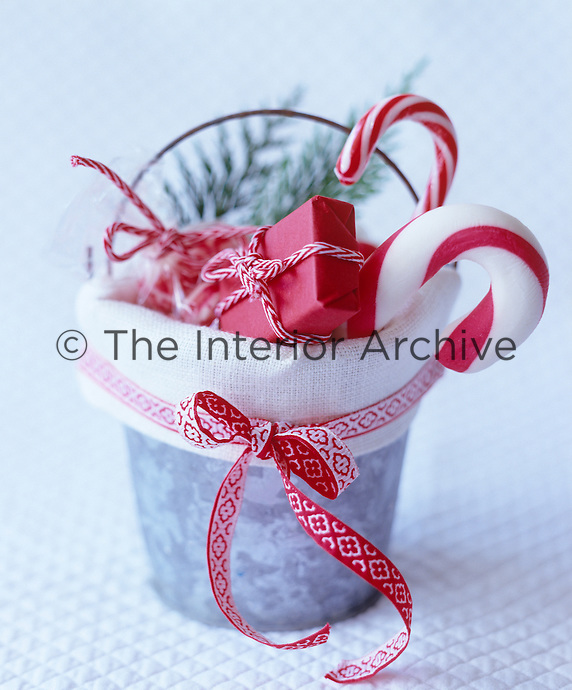 A galvinised bucket lined with linen and filled with little presents and candy canes makes an excellent gift