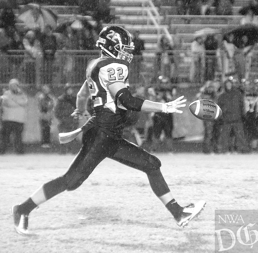 Photo by Randy Moll<br /> Gravette senior, Jackson Soule', boots one away during play against Shiloh Christian on a rainy night in Gravette on Friday, Oct. 30, 2015.