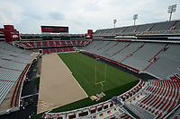 NWA Democrat-Gazette/ANDY SHUPE<br /> Work continues Wednesday, Aug. 7, 2019, to install a turf playing surface at Razorback Stadium in Fayetteville.