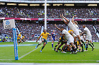 Will Genia of Australia has his clearance kick charged down by Mako Vunipola of England resulting in a try during the QBE Autumn International match for the Cook Cup between England and Australia at Twickenham on Saturday 2nd November 2013 (Photo by Rob Munro)