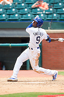 Darnell Sweeney (9) of the Chattanooga Lookouts follows through on his swing against the Montgomery Biscuits at AT&T Field on July 23, 2014 in Chattanooga, Tennessee.  The Lookouts defeated the Biscuits 6-5. (Brian Westerholt/Four Seam Images)