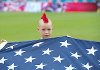 15 September 2012: One of the United States of America flag bearers sports a very unique hair cut during the opening ceremonies of an MLS game between the Philadelphia Union and Toronto FC at BMO Field in Toronto, Ontario..The game ended in a 1-1 draw..