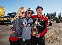 Feb 11, 2019; Pomona, CA, USA; NHRA top alcohol funny car driver Brian Hough celebrates with crew chief Jonnie Lindberg after winning the Winternationals at Auto Club Raceway at Pomona. Mandatory Credit: Mark J. Rebilas-USA TODAY Sports