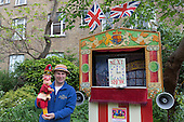 Covent Garden, London, UK. 11 May 2014. Puppeteer Benjamin Hasker with Mr Punch in from of his Punch & Judy theatre in the churchyard of St. Paul's. The Covent Garden May Fayre and Puppet Festival takes place at St Paul's Church.