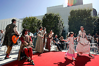 Louis XIV (seated), played by Bryan Mercer, and other members of the French-language troupe Théâtre du Rêve entertain people during the pubic opening of Louvre Atlanta at the High Museum of Art. Over the next three years, the High Museum will feature hundreds of works of art from the Musée du Louvre in Paris.
