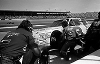Dale Earnhardt makes a pit stop enroute to a  6th place finish in the Pepsi 400 at Daytona in July 1987. (Photo by Brian Cleary)