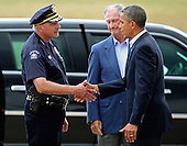 United States President Barack Obama (R) is greeted by Aurora Police Chief Dan Oates (L) and Aurora Mayor Steve Hogan after arriving at Buckley Air Force Base July 22, 2012 in Aurora, Colorado. Obama traveled to the University of Colorado Hospital to meet with victims of last Friday's movie theater mass shooting. Police in Aurora, a suburb of Denver, say that James Holmes, 24, in custody after he is suspected of killing 12 people and injuring 59 during a midnight screening of 'The Dark Knight Rises' last Friday. .Credit: Chip Somodevilla / Pool via CNP