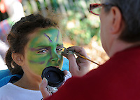 MORRISVILLE, PA - OCTOBER 25: Jasmin Hall (L), 6, of Bensalem, Pennsylvania has her face painted by Luanne Dietrich during  Healthy Families Weekend at Snipes Farm and Education Center October 25, 2014 in Morrisville, Pennsylvania. The event runs through Sunday. (Photo by William Thomas Cain/Cain Images)