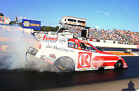 Aug. 16, 2013; Brainerd, MN, USA: NHRA funny car driver Tim Wilkerson during qualifying for the Lucas Oil Nationals at Brainerd International Raceway. Mandatory Credit: Mark J. Rebilas-