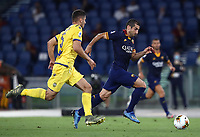 Football, Serie A: AS Roma - Hellas Verona Fc, Olympic stadium, Rome, July 15, 2020. <br /> Roma's Henrikh Mkhitaryan (r) in action with Verona's Davide Faraoni (l) during the Italian Serie A football match between Roma and Hellas Verona at Rome's Olympic stadium, on July 15, 2020. <br /> UPDATE IMAGES PRESS/Isabella Bonotto