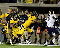 Isi Sofele of California runs the ball during the game against Washington at Memorial Stadium in Berkeley, California on November 2nd, 2012.  Washington Huskies defeated California, 13-21.