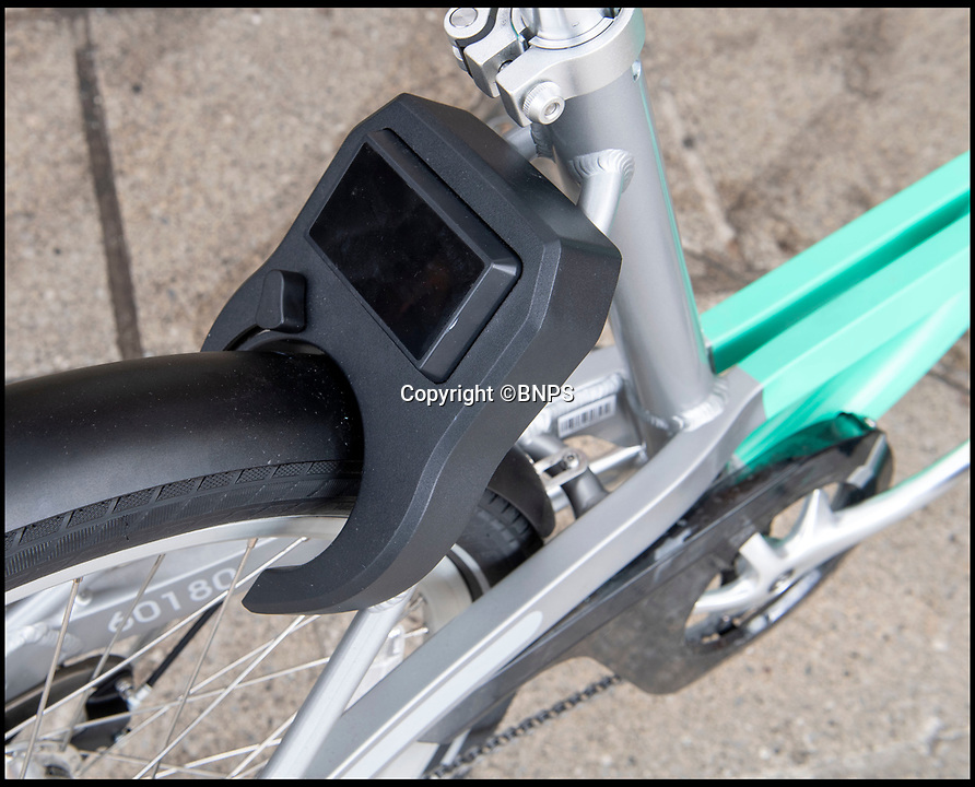 BNPS.co.uk (01202 558833)<br /> Pic: PhilYeomans/BNPS<br /> <br /> Locks prevet the bikes being stolen after use.<br /> <br /> An innovative bike share scheme has been wheeled out in a popular seaside resort as part of a bid to reduce congestion.<br /> <br /> The Beryl Bikes, which can be hired through a smartphone app, will be dotted around designated bays in Bournemouth and Poole, Dorset.<br /> <br /> It is the first time cycling firm Beryl have offered a citywide bike-hire service and will aim to reduce traffic in the bustling coastal region.