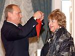 Russian President Vladimir Putin awards the Order of Merit 2 nd grade to Natalya Durova art director of the Durov Animal Theatre.