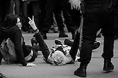 San Francisco, California.USA.March 20, 2003..Thousands of anti-Iraqi war protesters take to the streets to oppose the US war on Iraq which began the previous evening. 1,000 protesters were arrested in San Francisco on this day.