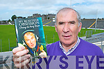 Broadcasting legend Weeshie Fogarty with the first copy of his  new autobiography My Beautiful Obsession, Chasing the Kerry Dream which he received on Monday, Weeshie is pictured in Fitzgerald Stadium and St Finian's Hospital is in the background both places have been significant Weeshie's life