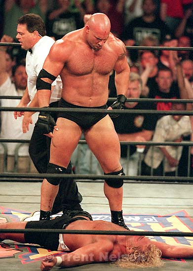 Goldberg looks down at defeated Curt Hennig at WCW's Bash at the Beach.<br />