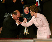 Sayed Hamed Gailani kisses the hand of first lady Laura Bush as they arrive for United States President George W. Bush's annual State of the Union Address to a Joint Session of the United States Congress in the Capitol in Washington, D.C. on January 31, 2006.  Fawzia Koofi looks on from center.<br /> Credit: Ron Sachs - CNP<br /> (RESTRICTION: NO New York or New Jersey Newspapers or newspapers within a 75 mile radius of New York City)