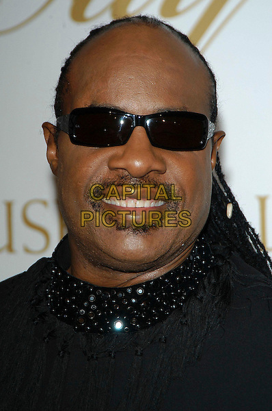 STEVIE WONDER.arriving at the Ray Charles Performing Arts Center fund raiser Gala held at the Beverly Hilton Hotel, Beverly Hills, California, USA,.29th September 2004..portrait headhshot dark sunglasses.Ref: ADM.www.capitalpictures.com.sales@capitalpictures.com.©CH/AdMedia/Capital Pictures .