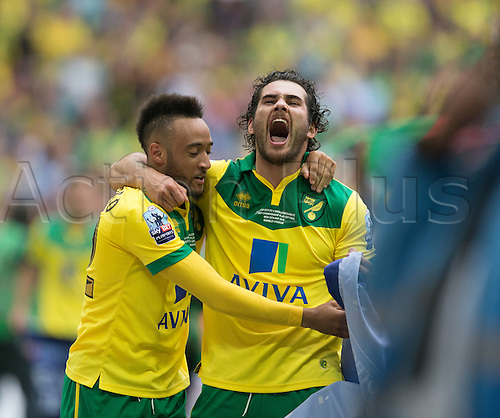 25.05.2015.  London, England. Skybet Championship Playoff Final. Middlesborough versus Norwich. Norwich City's Bradley Johnson shouts with delight after his sides victory as they get promoted to the Premiership.