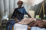 Mcc0075406 . Daily Telegraph<br /> <br /> DT Foreign<br /> <br /> Nyalok Mabor 45 yrs with her daughter Dalia who is suffering from severe malnutrition .<br /> <br /> The IMC Paediatric ward in POC 3 , a &quot;Protection of Civilian Camp&quot; inside the vast UN compound on the outskirts of Juba . Parents bring their children in with acute malnutrition needing urgent treatment .<br /> <br /> Over 20,000 civilians who predominantly fled from conflict in the equatorial states of South Sudan . United Nation's agencies recently announced a famine in the war torn country .<br /> <br /> Juba 27 February 2017