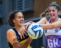 Aliyah Dunn (left) and Kate Burley compete for the ball during the ANZ Premiership netball match between the Central Pulse and Northern Stars at Te Rauparaha Arena in Wellington, New Zealand on Wednesday, 3 April 2019. Photo: Dave Lintott / lintottphoto.co.nz