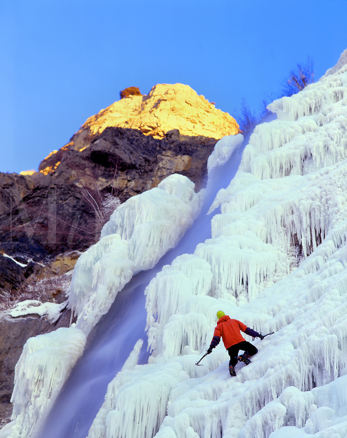 Ice climber Matt Hoskisson enjoys late afternoon on Bridal Veil Falls, Wasatch Mts. Utah.  (M.R.)