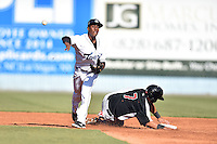 Asheville Tourists shortstop Luis Jean (3) makes the turn on a double play over a hard sliding Jose Trevino (7) during game one of a double header against the Hickory Crawdads on April 21, 2015 in Asheville, North Carolina. The Crawdads defeated the Tourists 10-1. (Tony Farlow/Four Seam Images)