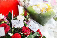 Pictured: Flowers outside Matalan store in Cardiff, Wales, UK where a couple were killed. Thursday 29 September 2016<br /> Re: Police are continuing to question a man on suspicion of murdering a couple who were found stabbed on a Cardiff street near to where they worked.<br /> Matalan workers Zoe Morgan, 21, and Lee Simmons, 33, were found dead close to the store on Queen Street at about 05:50 BST on Wednesday.<br /> Andrew Saunders from Castleton, Newport, who is known to the couple, is in custody.<br /> He was arrested within an hour of their bodies being found and officers are not looking for anyone else.Pictured: <br /> Re: Police are continuing to question a man on suspicion of murdering a couple who were found stabbed on a Cardiff street near to where they worked.<br /> Matalan workers Zoe Morgan, 21, and Lee Simmons, 33, were found dead close to the store on Queen Street at about 05:50 BST on Wednesday.<br /> Andrew Saunders from Castleton, Newport, who is known to the couple, is in custody.<br /> He was arrested within an hour of their bodies being found and officers are not looking for anyone else.