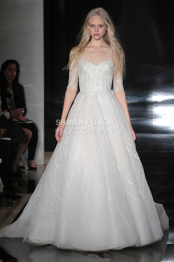 Model walks runway in an embroidered illusion ball gown, from the Reem Acra Spring 2017 bridal collection, during New York Bridal Fashion Week Spring Summer 2017, on April 15, 2016.