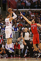 12/09/12 Los Angeles, CA: Los Angeles Clippers power forward Blake Griffin #32 Toronto Raptors center Andrea Bargnani #7 during an NBA game between the Los Angeles Clippers and the Toronto Raptors played at Staples Center. The Clippers defeated the Raptors 102-83.