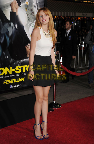 WESTWOOD, CA- FEBRUARY 24: Actress Bella Thorne arrives at the 'Non-Stop' - Los Angeles Premiere at Regency Village Theatre on February 24, 2014 in Westwood, California.<br /> CAP/ROT/TM<br /> &copy;Tony Michaels/Roth Stock/Capital Pictures