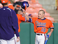 Addison Johnson (18) is congratulated after scoring a run in a game between the Charlotte 49ers and Clemson Tigers Feb. 20, 2009, at Doug Kingsmore Stadium in Clemson, S.C. (Photo by: Tom Priddy/Four Seam Images)