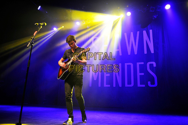 LONDON, ENGLAND - SEPTEMBER 15: Shawn Mendes performing at Shepherd's Bush Empire on September 15, 2015 in London, England.<br /> CAP/MAR<br /> &copy; Martin Harris/Capital Pictures