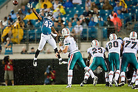 August 21, 2010: Miami vs Jacksonville:   Jacksonville Jaguars safety Gerald Alexander (42) goes up high in an attempt to block a pass by Miami Dolphins quarterback Chad Henne (7) during action between the Jacksonville Jaguars and the Miami Dolphins at EverBank Field in Jacksonville, Florida.  Miami defeated Jacksonville 27-26..........