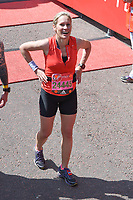 Sophie Raworth<br /> carried away by St John's Ambulance at the finish line on The Mall at the 2017 London Marathon, London. <br /> <br /> <br /> &copy;Ash Knotek  D3254  23/04/2017