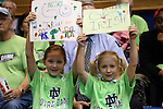 01 February 2016: Two young Notre Dame fans. The Duke University Blue Devils hosted the University of Notre Dame Fighting Irish at Cameron Indoor Stadium in Durham, North Carolina in a 2015-16 NCAA Division I Women's Basketball game. Notre Dame won the game 68-61.
