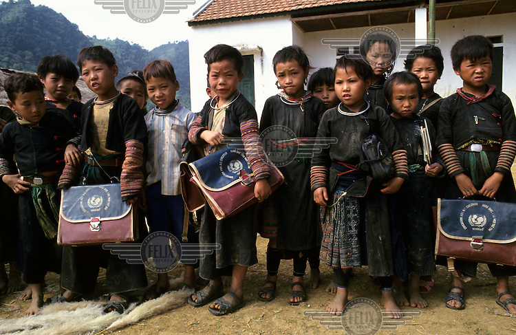Ethnic Hmong (Miao) children on their way to a school supported by a UNICEF educational programme.