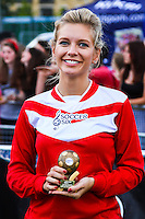 London, UK on Sunday 31st August, 2014. Rachel Riley with her trophy during the Soccer Six charity celebrity football tournament at Mile End Stadium, London.