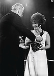"""Elizabeth Taylor receiving her award from the British Film Academy for Top Actress for her performance in """"Who's Afraid of Virginia Woolf"""", April 1967."""